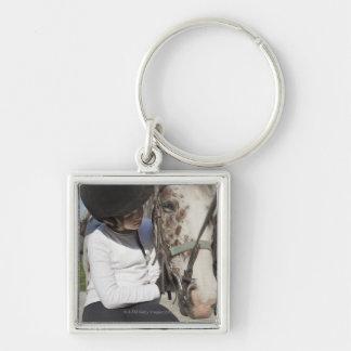 Niña con su caballo llavero cuadrado plateado