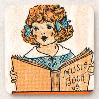 niña de los años 20 con el libro de música posavasos