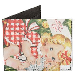 Niña linda del vintage con una muñeca billeteras tyvek®