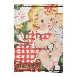 Niña linda del vintage con una muñeca tarjeteros tyvek®