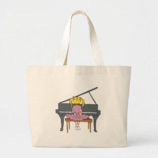 niña que juega el piano bolsas lienzo