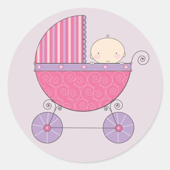 Niña rosada y púrpura en carro pegatina redonda