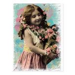 Niña y flores del vintage postal