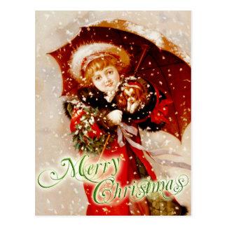 Niña y perrito en la nieve del navidad tarjetas postales