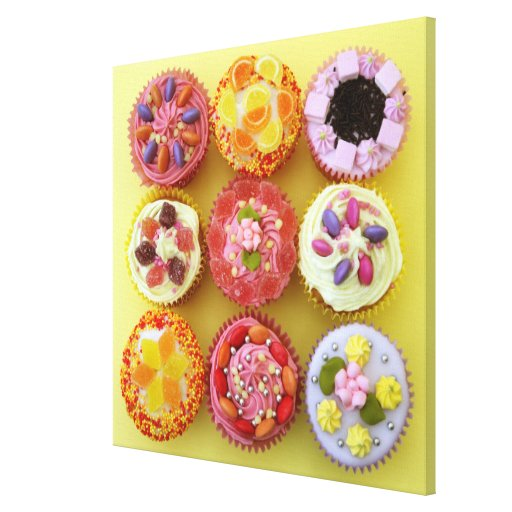 Nine cupcakes each decorated with candy in a canvas print