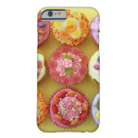 Nine cupcakes each decorated with candy in a barely there iPhone 6 case
