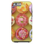 Nine cupcakes each decorated with candy in a iPhone 6 case