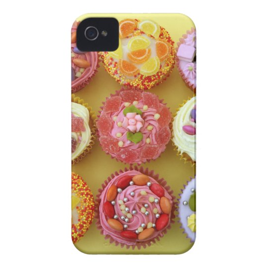 Nine cupcakes each decorated with candy in a iPhone 4 case