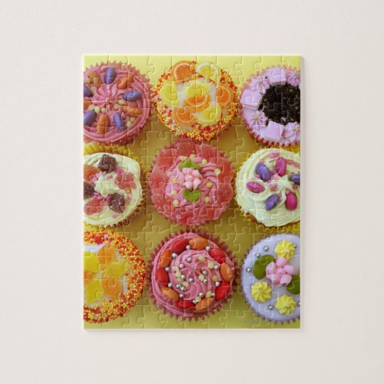 Nine cupcakes each decorated with candy in a jigsaw puzzle