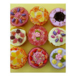 Nine cupcakes each decorated with candy in a poster