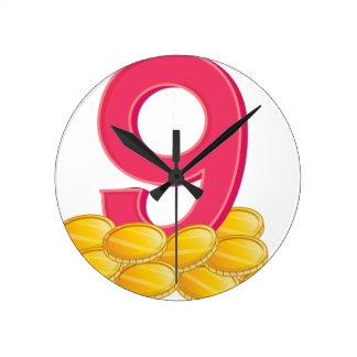 Nine gold coins round clock