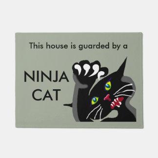 Ninja cat on guard doormat
