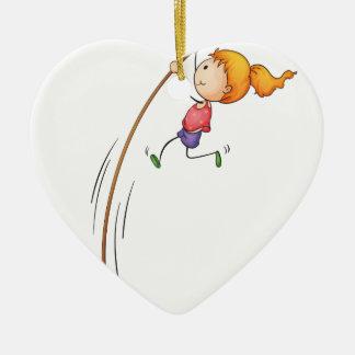 Niño activo adorno navideño de cerámica en forma de corazón