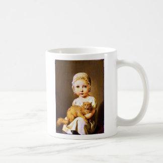 Niño con el gato taza