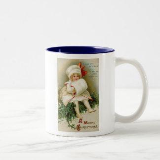 Niño con el manguito taza