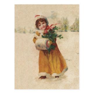 Niño de la nieve del vintage en capa amarilla postales