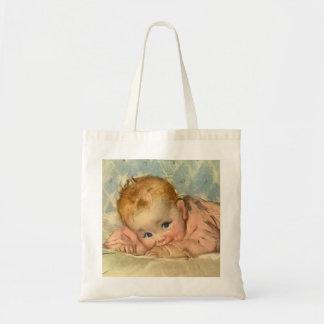 Niño de los niños del vintage, niña linda en la bolsa tela barata