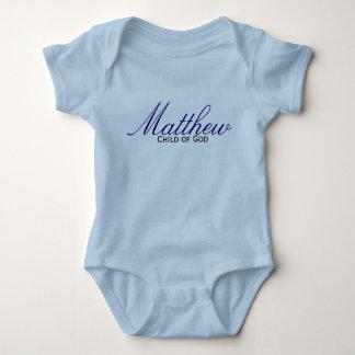 Niño del bautismo del muchacho azul del remeras