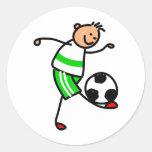 Niño del fútbol etiqueta redonda