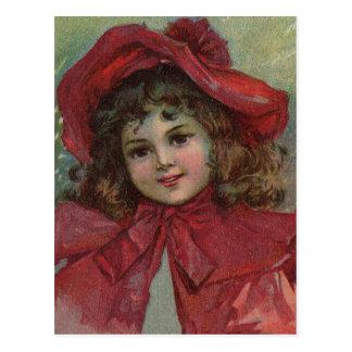 Niño del navidad del vintage con el vestido rojo postal