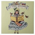 Niño del vintage con el libro de Papá Noel Tejas Ceramicas