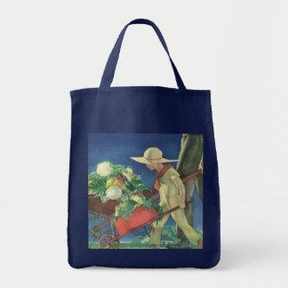 Niño del vintage, el cultivar un huerto orgánico; bolsa tela para la compra
