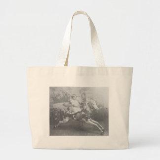niño en caballo del carrusel bolsa tela grande