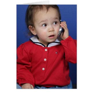 Niño en el teléfono celular tarjeta