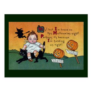 Niño en el vintage Halloween del gato y de los Postales