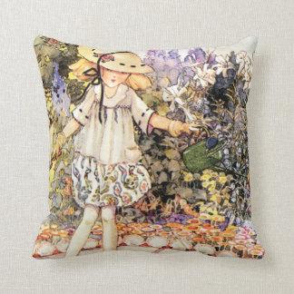 Niño en jardín almohadas