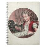 Niño en la máquina de coser cuaderno