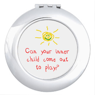 Niño interno espejos compactos