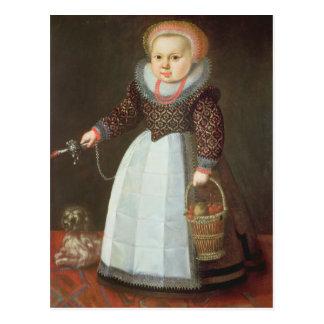 Niño joven con un perro postal