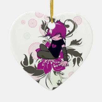 niño lindo del emo que se sienta en una flor adorno de cerámica en forma de corazón