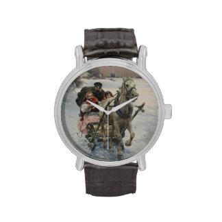 Niño que conduce un trineo traído por caballo relojes de pulsera