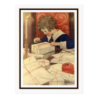Niño que envuelve presentes de Jessie Willcox Smit Tarjetas Postales