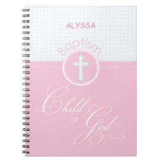 Niño rosado de la enhorabuena del bautismo de libreta