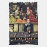 Niño y naranjas toallas de cocina
