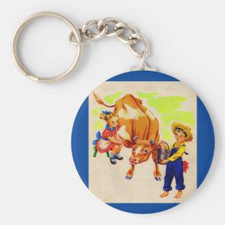 niños adorables con la vaca adorable llavero redondo tipo pin