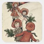 Niños con las bolas de nieve que lanzan del acebo colcomania cuadrada