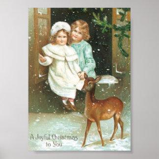 Niños con un ciervo en navidad impresiones