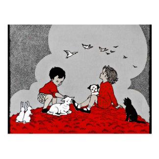 Niños con un cordero postal