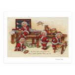 Niños de GreetingLittle del navidad en el banco de Tarjeta Postal
