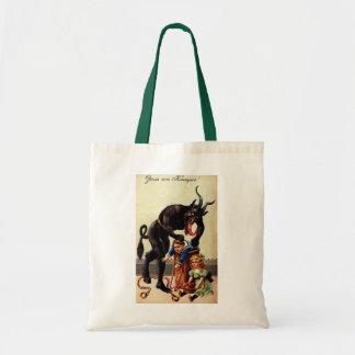 Niños de Krampus en la bolsa de asas del navidad