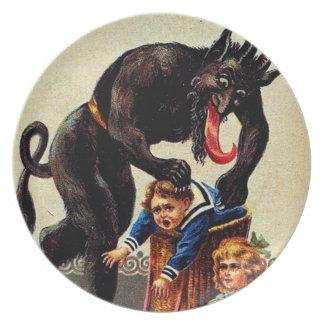Niños de Krampus en placa del navidad del día de Platos Para Fiestas