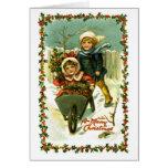 Niños de la tarjeta de Navidad del vintage en niev