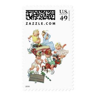 Niños de los niños del vintage que juegan con los sello