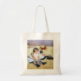 Niños de Mary Cassatt que juegan en la playa Bolsas Lienzo