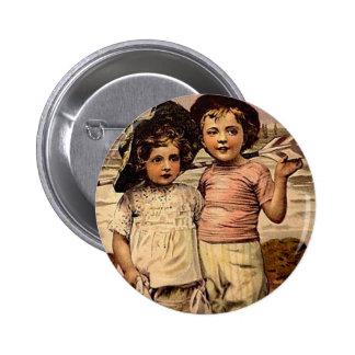 Niños del Victorian del vintage en la playa Pin