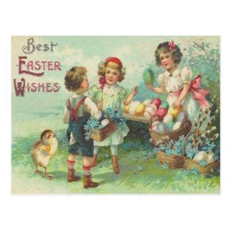 Niños del vintage con la tarjeta de pascua de los  postales